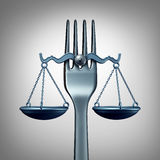 Food Law. And legal regulations concept with a kitchen fork shaped as a scale of justice as a symbol for nutrition inspection or eating legislation rules as a Royalty Free Stock Images