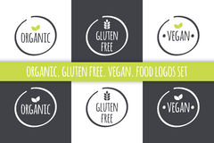 Food logos set. Organic Gluten Free Vegan labels. Vector grey white  symbols with green leaves. Food logos set. Organic Gluten Free Vegan labels. Vector  symbols Stock Images
