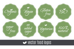 Food logos set. Organic Vegan Sugar Gluten free Bio Vegetarian 100 Natural labels. Vector green stickers isolated on white backgro. Food logos set. Organic Vegan Royalty Free Stock Photos