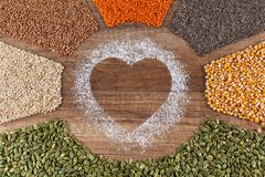 Food with love concept with various seeds and grains royalty free stock photography