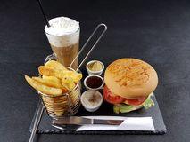 Food lunch dinner tasty chips burger sauces cutlery plate drink tasty Royalty Free Stock Photography