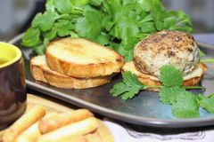 Food, lunch. Meat cutlet with toast, cilantro and parsley on a p stock image