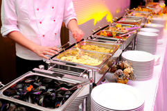 Food on the luxury pary. Food with hands of cook and colorful lights Royalty Free Stock Photography