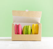 Macaron box on white wooden table Royalty Free Stock Photography