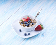 Food made of granola and musl a blue wooden table top view Stock Images