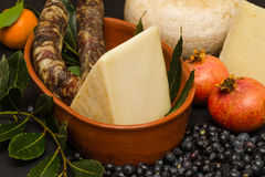 Food made in Sardegna. Set with cheese,sausage and fruit of Sardegna, Italy royalty free stock images