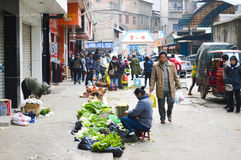 Food market. In Guiyang City, Guizhou Province, China, a grandmother stall selling vegetables on the street Stock Photos