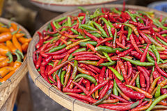 Food market with fresh chili peppers Stock Images