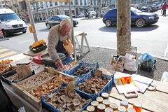 Food market in Geneva. Man buying food in vegetable market in Geneva, Sqitzerland. February 2015 royalty free stock photography