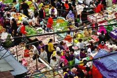Food market, Java, Indonesia. Vendors in stalls at open air food market in Java, Indonesia in daytime stock image