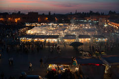 Food market in Marrakech. A busy food market in Marrakech with smoke rising from numerous barbecues Royalty Free Stock Photo