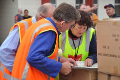 Food for the masses. Volunteers receive directions on where to take food for victims of the 6.4 earthquake in Christchurch, South Island, New Zealand, 22-2-2011 Stock Photo
