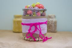 Colorful popcorn in a jar background space for text Royalty Free Stock Photos
