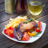 Food. Meat barbecue with vegetables on wooden surface. Royalty Free Stock Image