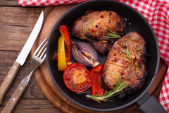 Food. Meat barbecue with vegetables on wooden surface. Royalty Free Stock Photography