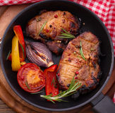 Food. Meat barbecue with vegetables on wooden surface. Royalty Free Stock Photos