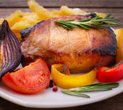Food. Meat barbecue with vegetables on wooden surface. Royalty Free Stock Images