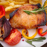 Food. Meat barbecue with vegetables on wooden surface. Stock Photography