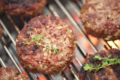 Food meat - beef burgers on bbq  barbecue grill. With flame. Shallow dof Stock Images