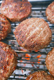 Food meat - beef burgers on bbq  barbecue grill with flame Stock Image