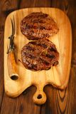 Food meat - beef steak on wooden board Royalty Free Stock Photography