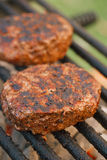 Food meat - burgers on bbq barbecue grill Royalty Free Stock Photography