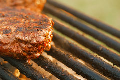 Food meat - burgers on bbq barbecue grill Royalty Free Stock Photo