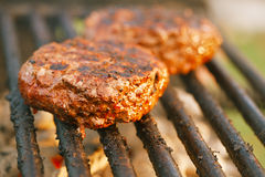 Food meat - burgers on bbq barbecue grill Stock Photography