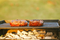 Food meat - burgers on bbq barbecue grill Stock Image