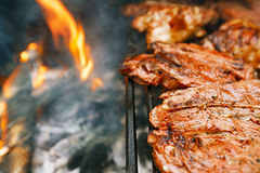 Food meat - chicken and beef on party summer barbecue grill Royalty Free Stock Images