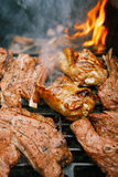 Food meat - chicken and beef on party summer barbecue grill Royalty Free Stock Photography