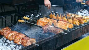 Food, meat, grill, street, barbecue, outdoor, pork, grilled, cooking, background, hot, meal, dinner, bbq, cook, fresh, vegetable,. Street food and outdoor royalty free stock image