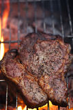 Food meat - rib eye beef steak on party summer barbecue grill wi Stock Photos