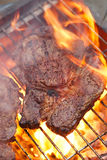 Food meat - rib eye beef steak on party summer barbecue grill wi Stock Image