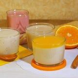 Food. Milk fruit berry dessert made of yogurt and cream with strawberries, orange and lemon. stock images