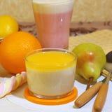 Food. Milk fruit berry dessert made of yogurt and cream with strawberries, pears, orange and lemon. stock photo