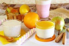 Food. Milk fruit berry dessert made of yogurt and cream with strawberries, pears, orange and lemon. royalty free stock photography