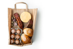 Food Mix Inside A Paper Bag On The White Background Royalty Free Stock Photos
