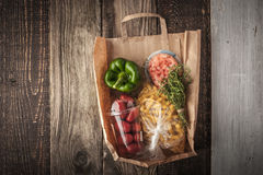 Food mix  inside a paper bag on the wooden background horizontal Stock Images