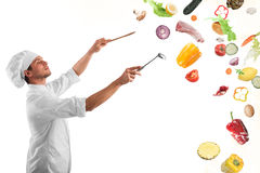 Food musical harmony. Chef creates a musical harmony with food royalty free stock image