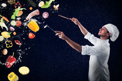Food musical harmony foe xmas menu. Chef creates a musical harmony with food and snow Royalty Free Stock Photography