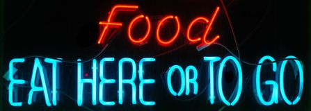 Food Neon Sign. Food - Eat Here or To Go Neon Sign Royalty Free Stock Photography