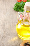 Food oil and spices on wood Stock Photos