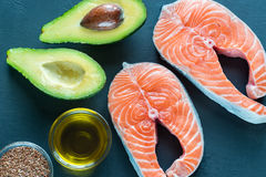 Food with Omega-3 fats. On the wooden board royalty free stock photography