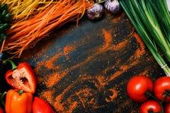 Food organic vegetable pasta assortment. Food organic vegetable tomato garlic pepper scallion pasta assortment concept Stock Photography