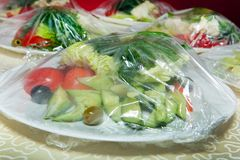 Food in the package, salad for fast food,. Vegetables in the cellophane Stock Photo