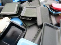 Food packages, egg cartons, to-go boxes styrofoam pile royalty free stock photography