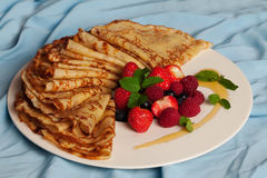 Food, pancakes with mint, strawberries Royalty Free Stock Images
