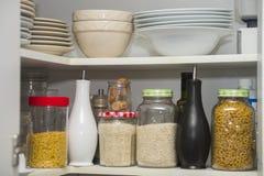 Food pantry with storage jars of pasta rice jasmine stock photos
