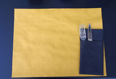 Food. Paper tablecloth with fork and knife. Short paper tablecloth, with fork and knife, on a table royalty free stock image